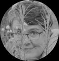 Amanda hides in paper daisies (B&W) circle